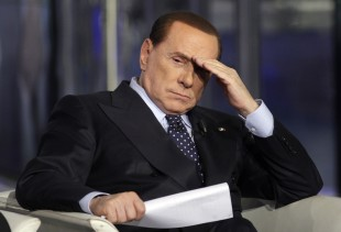 File photo shows Italy's former PM Berlusconi gesturing on a television show in Rome