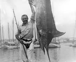 Ernest Hemingway posing with a marlin, Havana Harbor, Cuba. Credit Line: Ernest Hemingway Collection. John F. Kennedy Presidential Library and Museum, Boston.